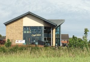 Christ Church Ministry Centre with the Scout & Guide HQ inbackground.